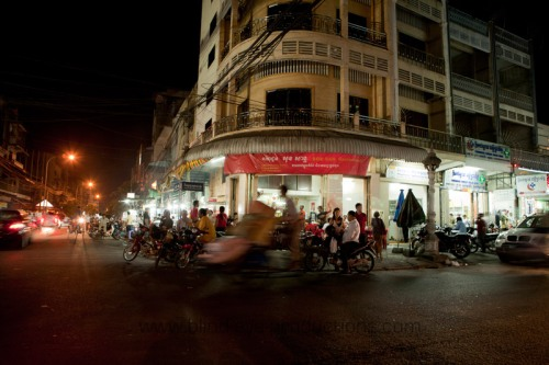 A cyclo goes past the Sok San Restaurant on the corner of 51 and 136
