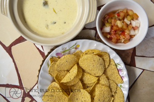 Nachos with queso dip and salsa